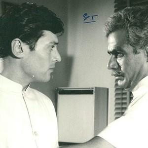 جواد قائم مقامی و ناصر ملک مطیعی در فیلم سینمایی «فرار از حقیقت»