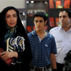 """نگار عابدی و پوریا ایمانی در نمایی از فیلم سینمایی """"گنجشکک اشی مشی"""""""