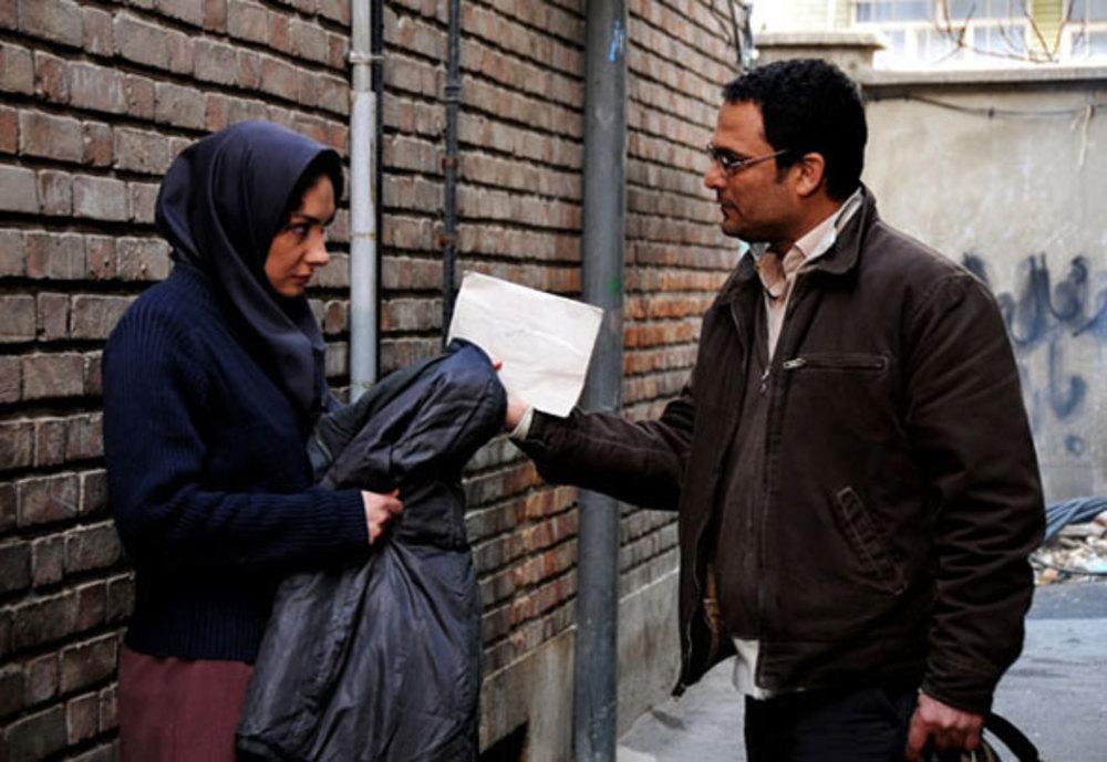 حسین یاری و هانیه توسلی در نمایی از فیلم ابرهای ارغوانی