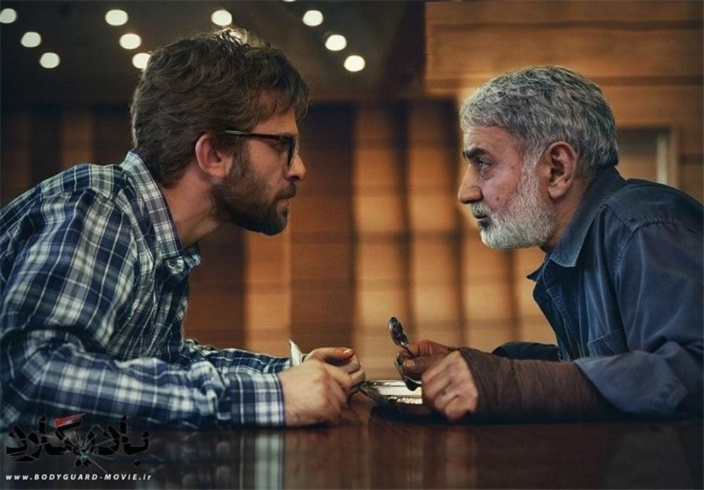 پرویز پرستویی و بابک حمیدیان در نمایی از فیلم «بادیگارد»