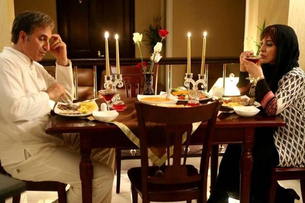 رویا نونهالی و حمیدفرخنژاد در نمایی از فیلم سینمایی «مشکل گیتی»