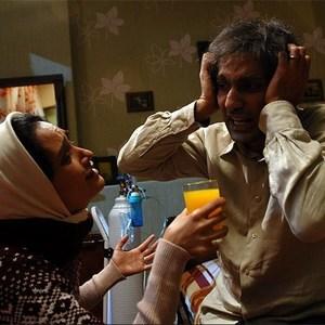 محمدرضا فروتن و میترا حجار در نمایی از فیلم سینمایی دلتنگی های عاشقانه