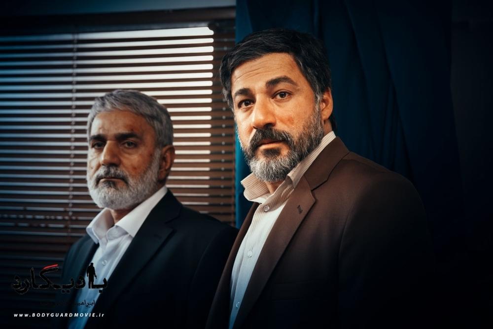 پرویز پرستویی و امیر آقایی در نمایی از فیلم «بادیگارد»