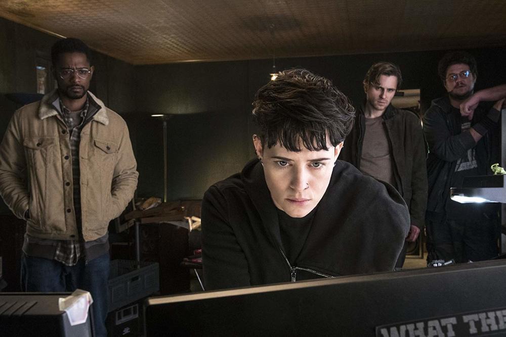 کلر فوی، لاکیت استنفیلد و سوریر گودنسون در نمایی از فیلم سینمایی «دختری در تار عنکبوت»