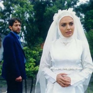 مرجان محتشم و بهرام رادان در فیلم «رز زرد»