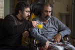 سیامک صفری و محسن تنابنده در نمایی از فیلم فراری